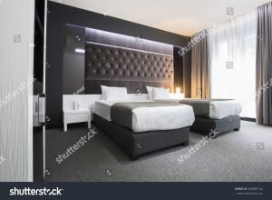 Double bed room decorated in black and white