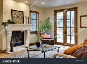 French door room with firplace