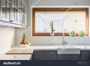 Kitchen with white counter top sink
